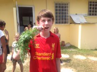 Boy eating carrot at Five Star Academy school Vegetable garden